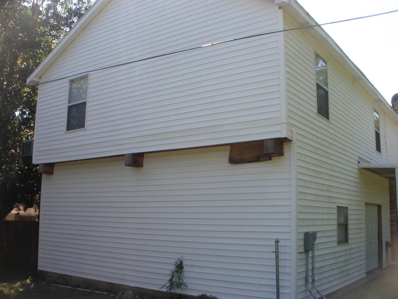 House wash vinyl siding after